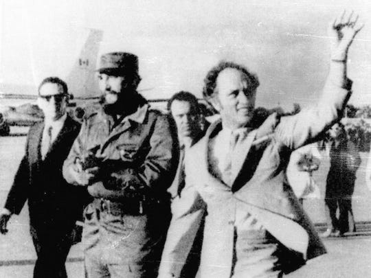 Canada's former prime minister Pierre Trudeau, right, waves in 1976 after arriving in Havana, accompanied by Cuban leader Fidel Castro. A false report claims Castro is the father of Justin Trudeau.