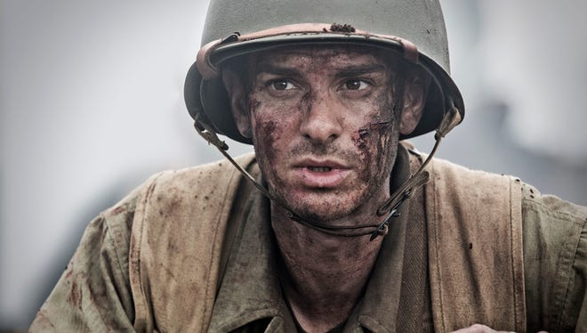 "Andrew Garfield as Desmond Doss in a scene from the movie ""Hacksaw Ridge"" directed by Mel Gibson. The movie is playing at Regal West Manchester Stadium 13, Frank Theatres Queensgate Stadium 13 and R/C Hanover Movies."