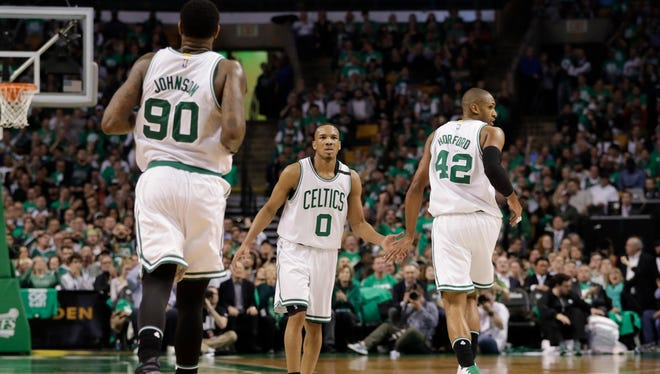 Boston Celtics guard Avery Bradley (0) and center Al Horford (42) react to a play against the Washington Wizards during the second half in Game 5.