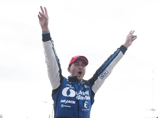 A whirlwind day ended in celebration for Graham Rahal,