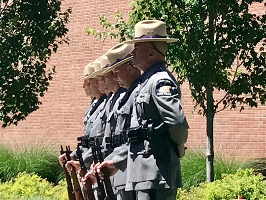 Officers prepare for 21-gun salute at Trooper Nicholas