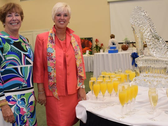 Event Chairs Sue Sharpe and Diane Wilhelm with the beautiful themed ice sculpture that was displayed during the Champagne Reception