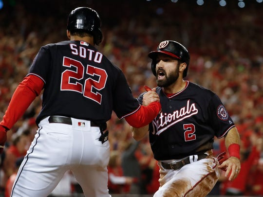 Washington Nationals' Adam Eaton celebrates with Juan Soto (22) after scoring on a hit by -Anthony Rendon during the third inning of Game 3 of the baseball National League Championship Series against the St. Louis Cardinals Monday, Oct. 14, 2019, in Washington. (AP Photo/Jeff Roberson)