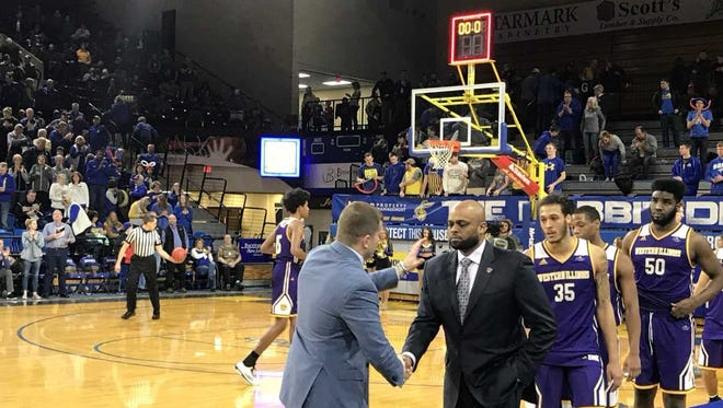 South Dakota State coach T.J. Otzelberger shakes hands with Western Illinois coach Billy Wright after SDSU's 82-62 win at Frost Arena