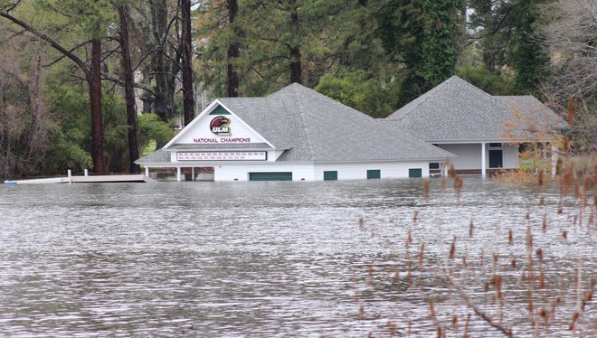 Water reaches almost to the roof of the University of Louisiana at Monroe's waterski team's boathouse, which was recently constructed, on Thursday.