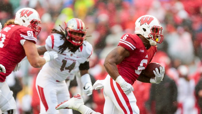 Wisconsin running back Corey Clement (6) runs for a touchdown as Wisconsin offensive lineman Tyler Marz (61) defends against Rutgers Kaiwan Lewis (14) during the first half of an NCAA college football game Saturday, Oct. 31, in Madison.