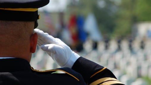 Soldier salutes fallen comrades.