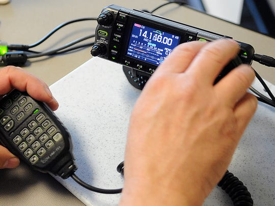 Gil Daniel, president of the Marshfield Area Amateur Radio Society, adjusts the frequency on a radio Saturday during an amateur radio field day in Marshfield.