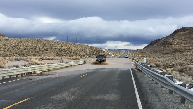 A Jeep plows through standing water on Pyramid Highway on Monday, Jan. 9, 2017.