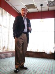 U.S. Sen. Lindsey Graham, R-S.C., meets with supporters Friday at Noah's Ark in Des Moines.
