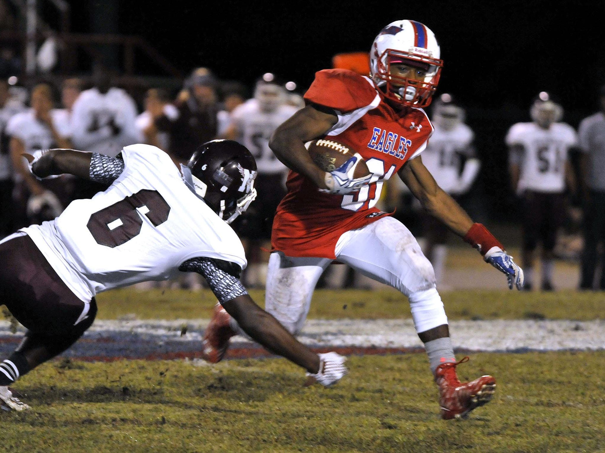 Devon Cooke of the Pine Forest Eagles manages to out maneuver Braijon Carr of the Niceville Eagles in first-half action in their game Friday night at Pine Forest High. However, Niceville went on to win the game 42-14.