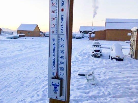 A thermometer shows a temperature of -65 degrees Celsius (-85 degrees Fahrenheit) in Tomtor village in the east of Yakutia on Jan. 14, 2018.