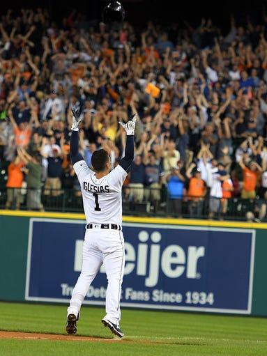 Detroit Tigers' Jose Iglesias throws his batting helmet