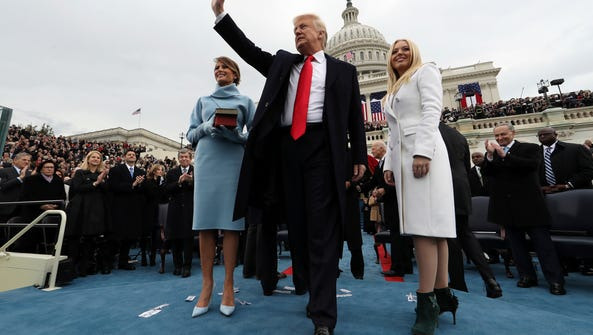 President Donald Trump waves after taking the oath