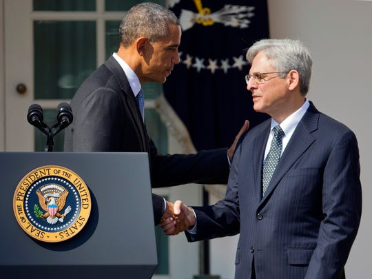 Federal appeals court judge Merrick Garland shakes hands with President Barack Obama as he is introduced as Obama's nominee for the Supreme Court on Wednesday.