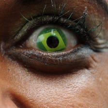 A woman wears contact lenses with the Brazilian national flag on June 30, 2013. (TASSO MARCELO/AFP/Getty Images)