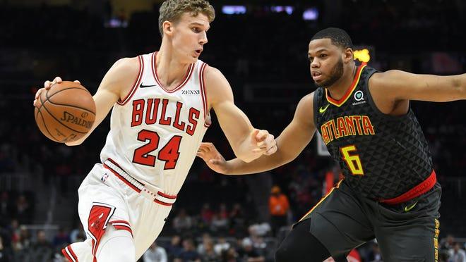 Chicago Bulls forward Lauri Markkanen drives toward the basket as Atlanta Hawks forward Omari Spellman defends during the first half Friday, March 1, 2019, in Atlanta.