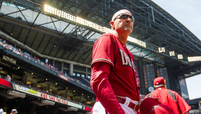 Diamondbacks manager Kirk Gibson waits for the anthem before playing against the Philadelphia Phillies at Chase Field in Phoenix.