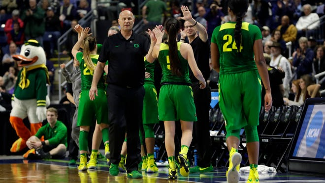 Mar 25, 2017; Bridgeport, CT, USA; Oregon Ducks head coach Kelly Graves congratulates his players in the last second of play as they take on the Maryland Terrapins during the second half in the semifinals of the Bridgeport Regional of the women's 2017 NCAA Tournament at Webster Bank Arena. Oregon defeated Maryland 77-63. Mandatory Credit: David Butler II-USA TODAY Sports