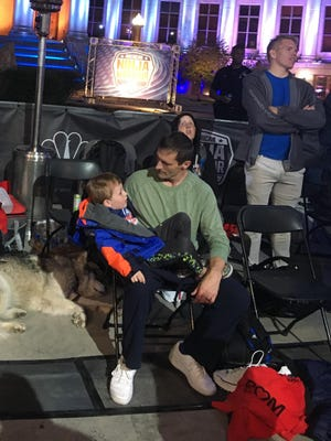 "Knoxville resident Todd Allen and his son Christian sit together while at the ""American Ninja Warrior"" Denver Qualifying Round."