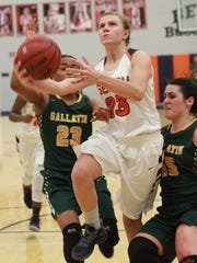 Beech's Mia Dean drives past Gallatin's Jo'Neca Talley
