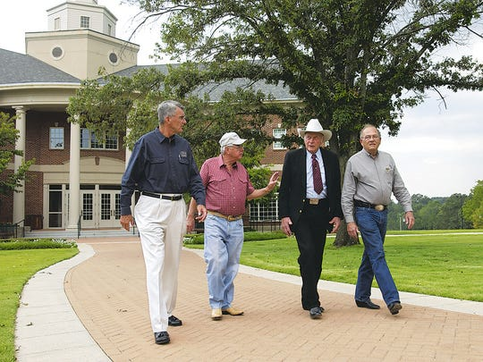 Twin Lakes Area luminaries (from right) Jim Gaston, Forrest L. Wood, Hugh McClain and Ed Coulter walk across the campus of Arkansas State University-Mountain Home in this 2005 photo.