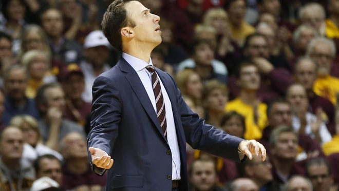 Minnesota head coach Richard Pitino checks the clock during the second half of an NCAA college basketball game against Michigan State Tuesday, Dec. 27, in Minneapolis.