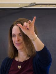 Molly Best leads her American Sign Language class at La Follette High School in Madison.