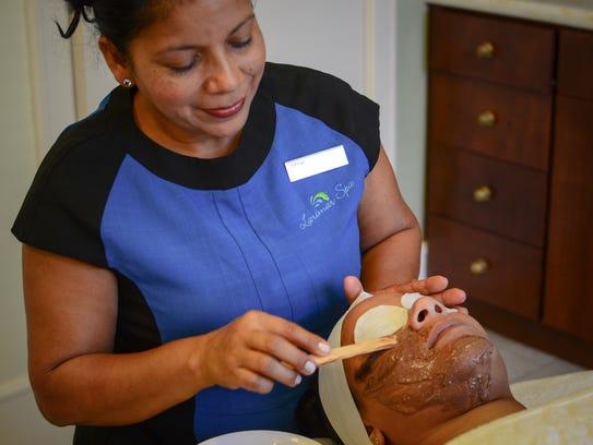 First up, masseuse Teresa Durango applies a scrub with