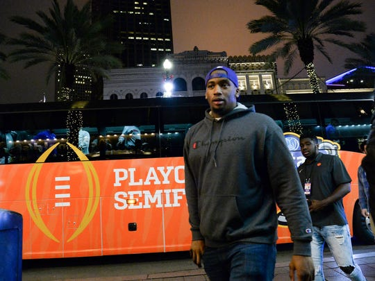 Clemson defensive end Clelin Ferrell and teammates walk from the team buses to dinner at Dickie Brennan's Steakhouse in New Orleans on Thursday night. Clemson orange is seen around the city. Sugar Bowl fans are starting to arrive and businesses on Bourbon Street and the area, flying the Clemson flag days before the January 1, 2018 Sugar Bowl.