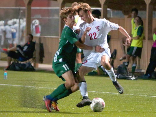 Wauwatosa West's Tyler Piek blocks Wauwatosa East's Ethan Engelken from the ball at the Wauwatosa Soccer Field on Sept. 19.