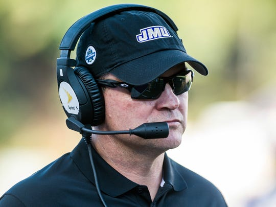 James Madison head coach Mike Houston paces down the sideline during the first half of an NCAA college football game against Villanova in Harrisonburg, Va., Saturday, Oct. 14, 2017.