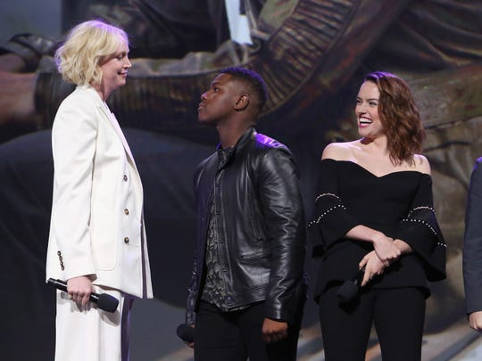 Gwendoline Christie (left) and John Boyega have a faux