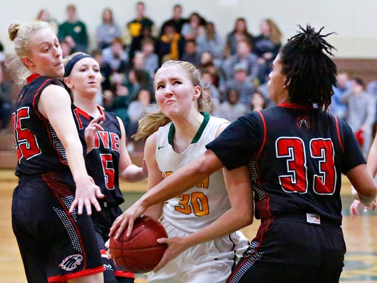 Dover's Rajah Fink, right, works to stop York Catholic's Katy Rader during girls' basketball action at York Catholic High School in York City, Wednesday, Dec. 20, 2017. Dover would win the game 48-41.Dawn J. Sagert photo