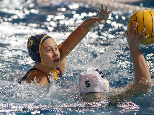 Akemi Von Scherr of La Quinta defends against Camille Dervieux of Xavier Prep in the DVL championship water polo match, February 7, 2018.