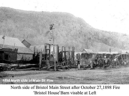 The north side of Bristol's Main Street after the 1898 fire. The Bristol House barn can be seen on the left.
