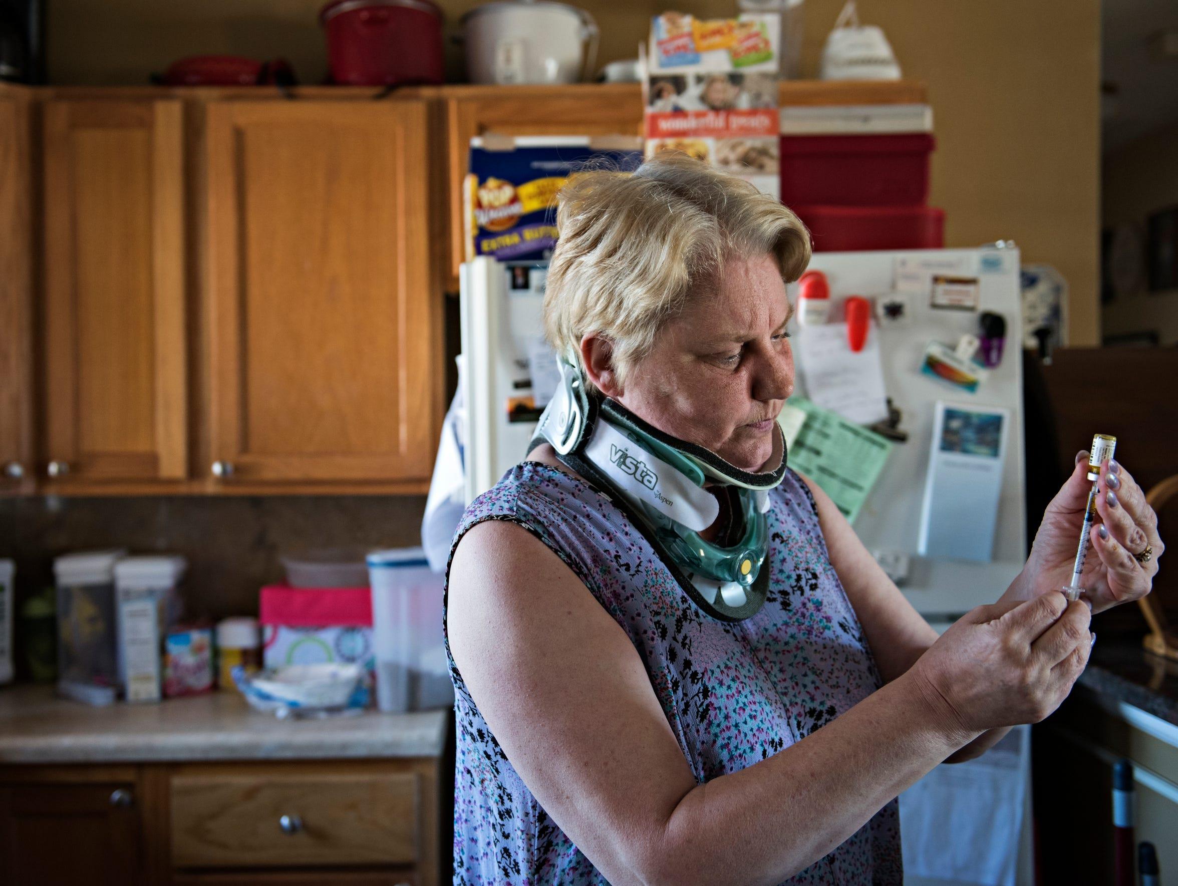 LaRita Jacobs has severe arthritis and delayed a neck