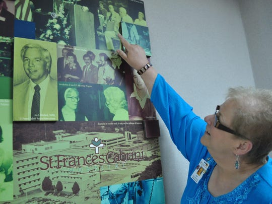 Joy Aldret Hirsch points to herself in the collage of photos taken at Cabrini in 1980. Hirsch and twin Roy Aldret were invited to the hospital's 30-year anniversary celebration and recognized as the hospital's first set of surviving twins.