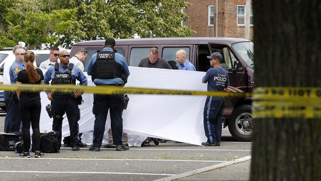 New Jersey Transit police conduct an investigation in the parking lot at the Matawan Aberdeen train station Friday, July 1, 2016.