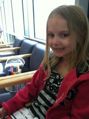 In 2012, then 6-year-old Taylor Robinson, looking pale