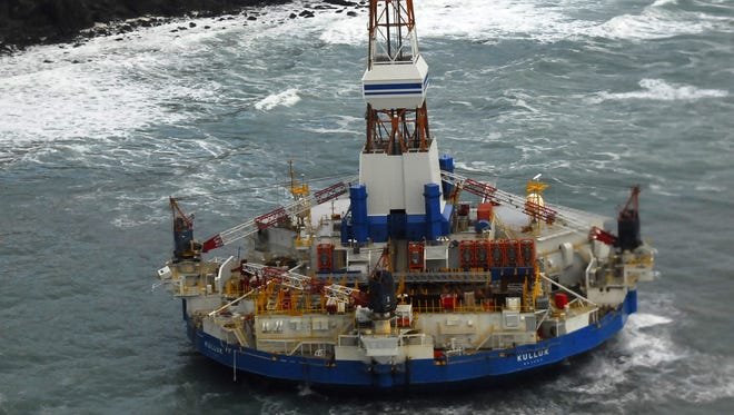 In this image provided by the U.S. Coast Guard the conical drilling unit Kulluk sits grounded 40 miles southwest of Kodiak City, Thursday, Jan. 3, 2012.