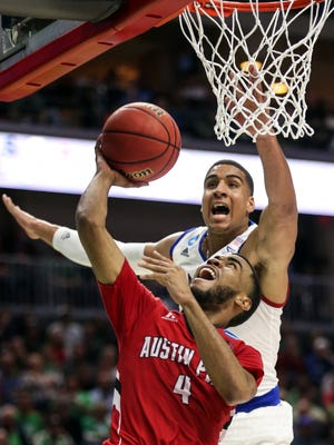 Josh Robinson of Austin Peay drives to the basket during the Kansas vs. Austin Peay NCAA men's basketball tournament first round game on Thursday, March, 17, 2016, in Wells Fargo Arena.
