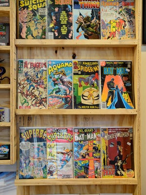 A selection of comics are for sale behind the register at Haywood Games and Comics.