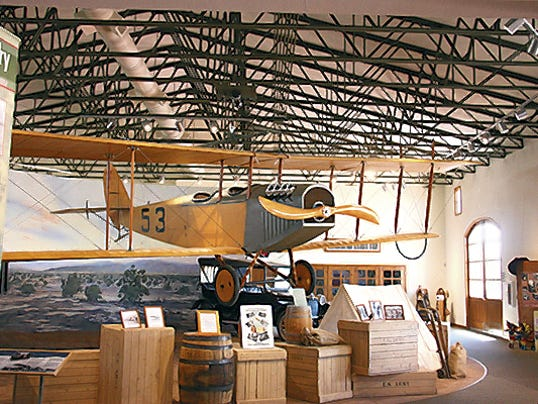 "A flying Jenny hangs above the Pancho Villa Exhibition Hall in Columbus. The Jenny airplanes were first used by the U.S. Army Air Corps during the Punitive Expedition in the hunt for Mexican Gen. Francisco ""Pancho"" Villa. The park offers history, camping and close proximity to the colorful border communities of Columbus and Palomas, Mexico."