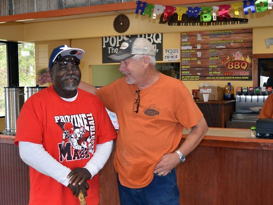 Owner Larry Allen, right, welcomes regular customer,