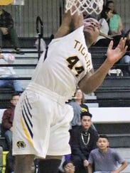 Alamogordo's Danilan Smith slams down a dunk during