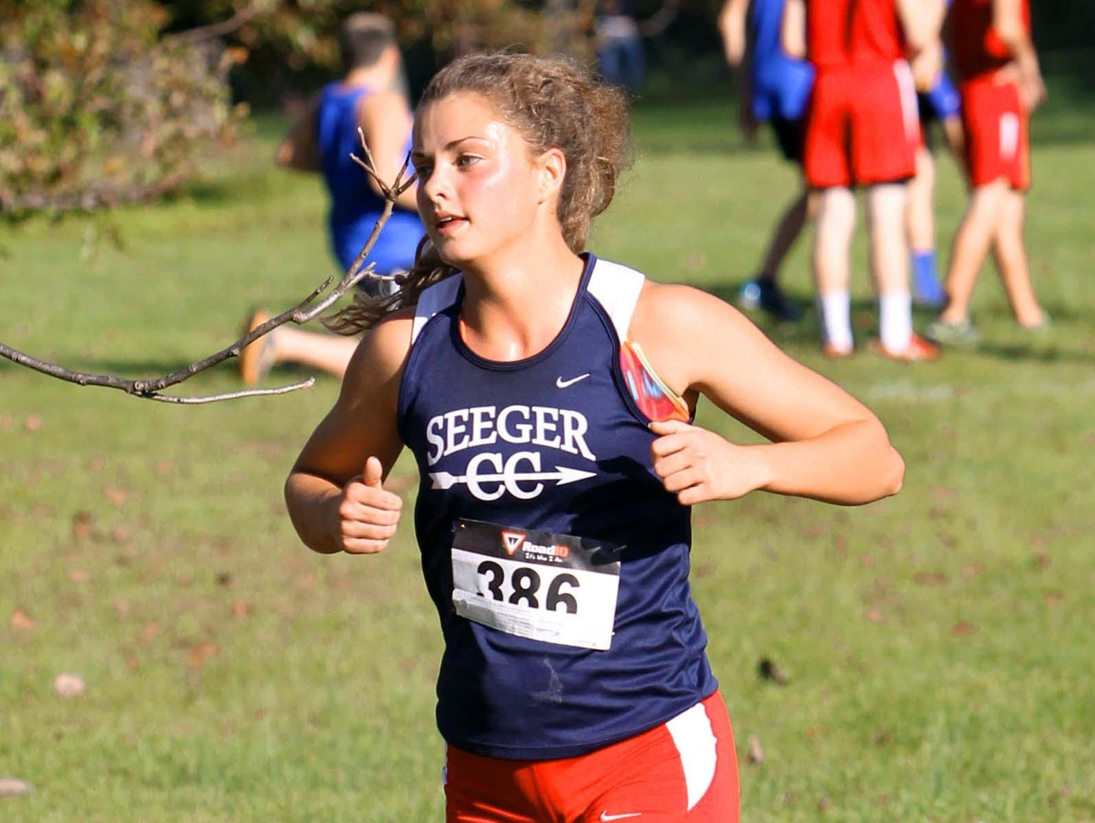 Becca Haussin of Seeger approximately 400 meters from the finish line at the Wabash River Conference cross country meet.