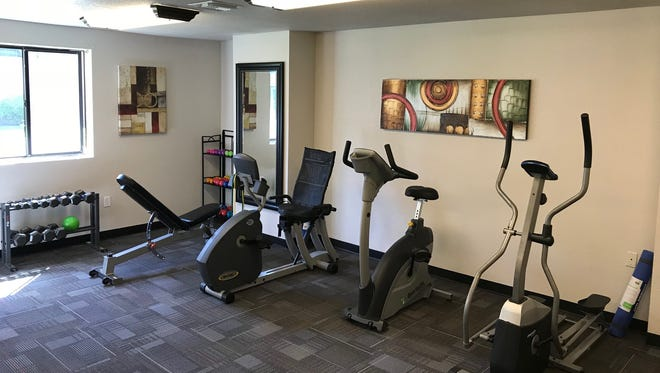 .  The bright open space features natural lighting, brand-new high-tech fitness equipment, a soft gym floor, a water cooler and a large-screen TV.