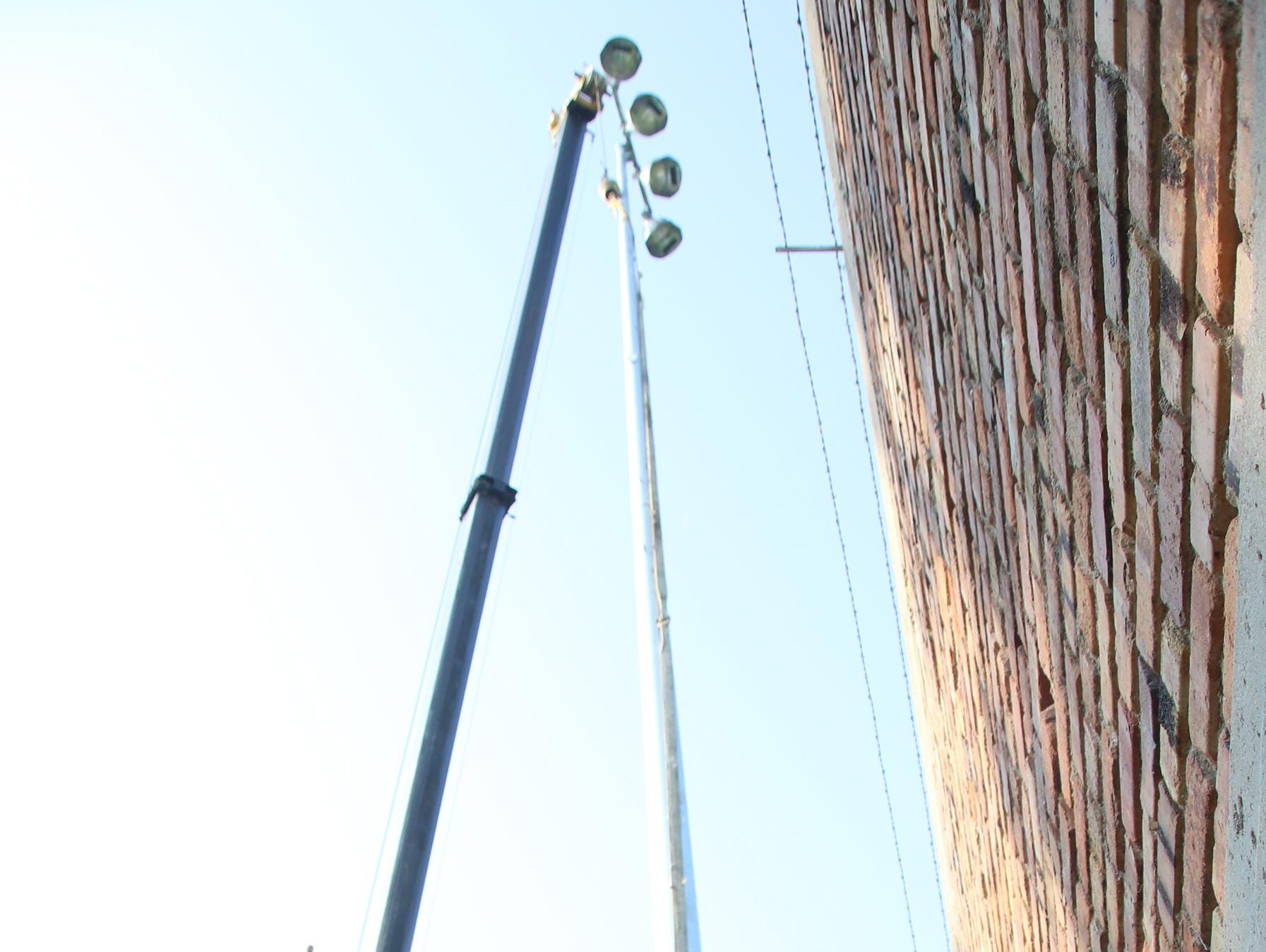 The first set of lights have been installed at Fort Dodge's Ed McNeil Field in time for Monday's game against Humboldt.