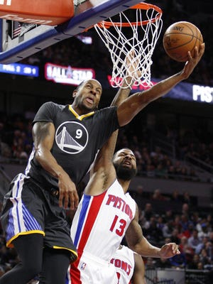 Golden State Warriors forward Andre Iguodala (9) attempts a shot against Detroit Pistons forward Marcus Morris on Jan. 16, 2016.